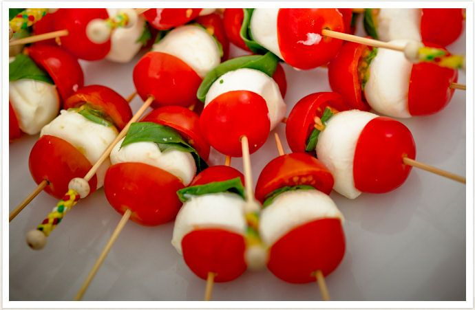 Cherry tomato's halved, mozzerella slices, basil leaves on a skewer. Drizzle with Italian salad dressing. Yummy!