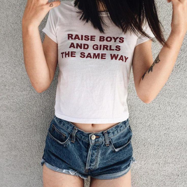 Acacia Brinley wearing Brandy Melville Raise Boys and Girls The Same Way Tee.