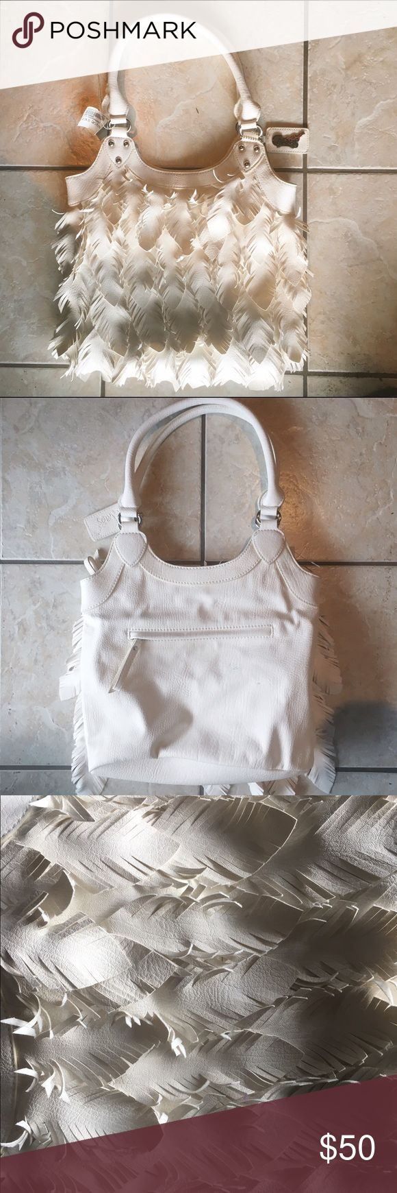 Carlos Santana White Feather Purse NWOT Never used, no rips or stains, very sturdy purse. Interior is a black and white polka dot. Unique feathers are individually cut and flow off of the handbag, looks beautiful! Carlos Santana Bags Totes