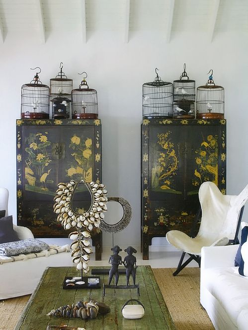 Asian style design. Gorgeous antique Chinese black lacquered cabinets, pretty birdcages combine with Indonesian elements. Stunning!