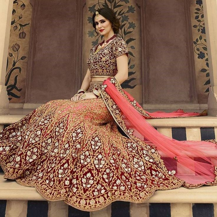 http://www.aishwaryadesignstudio.com/heavily-worked-pink-maroon-lehenga