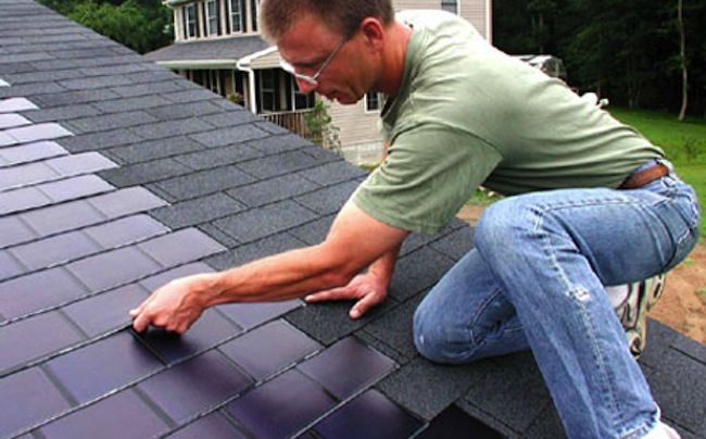http://www.prefabhomeparts.com/solarroofshingles.php has some info on the eco friendly benefits of solar roof shingles.