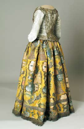 Caraco, early 18th century Croatia, Šibenik Bizarresilk in greyish-blue damask; gilded lace with zigzag patterned floral motif.  Dress, c. 1710.Croatia, Blato na KorčuliBrocaded Lyon silk damask. An exceptionally rich and expensive example ofbizarre silk design.  Museum of Arts and Crafts, Croatia