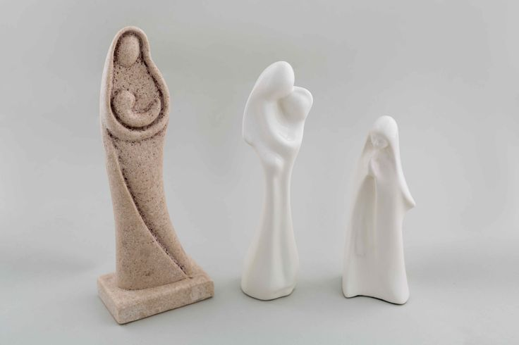 Variety of Virgin Mary statuettes in stone and porcelain.