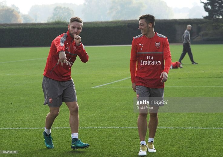 Shkodran Mustafi and Mesut Ozil of Arsenal during Arsenal Training Session at London Colney on October 14, 2016 in St Albans, England.