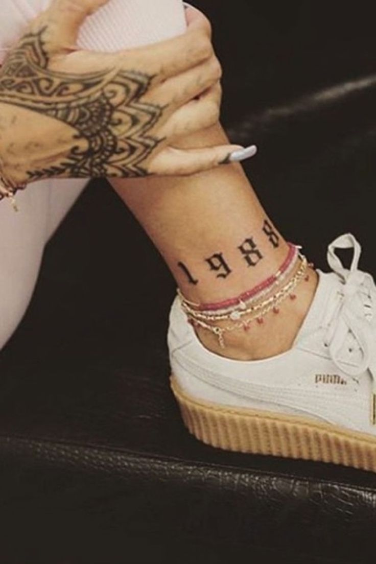 Can you guess which singer just unveiled *this* painful inking?