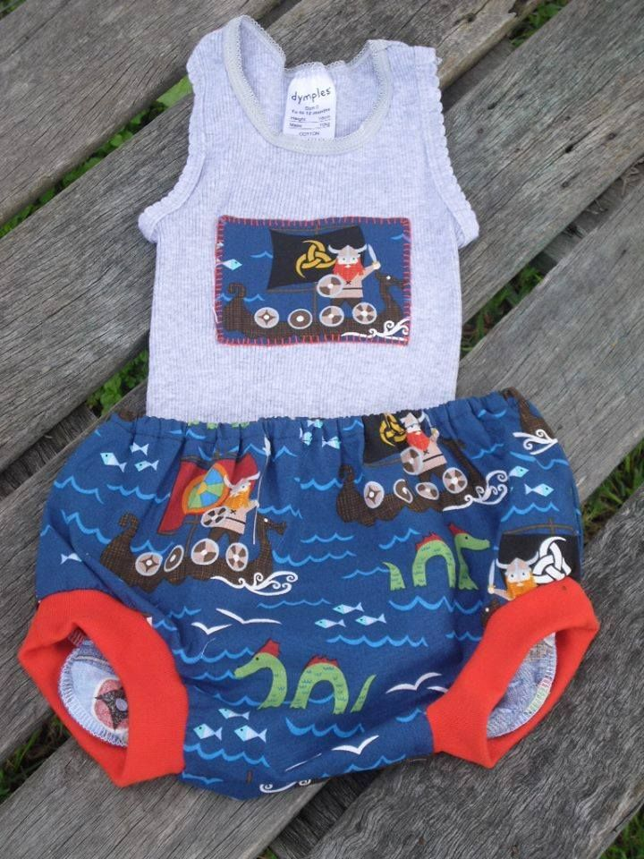 Size 0 Nappy Cover and Applique Singlet. For the Lads Market Night opens at 9pm, on Tuesday 3rd June, 2014. The first person to comment sold will be able to purchase the item direct from the business listed on the item.