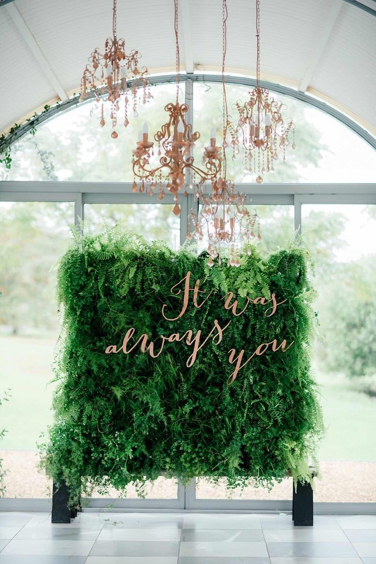 Metallic & green living wall decoration is a imaginative backdrop for your spring wedding