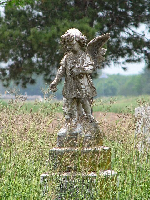Forgotten cemetery angel in Batesville, Texas. The town was once prosperous and thriving before a drought and the Great Depression took their toll.*informative about area on site*