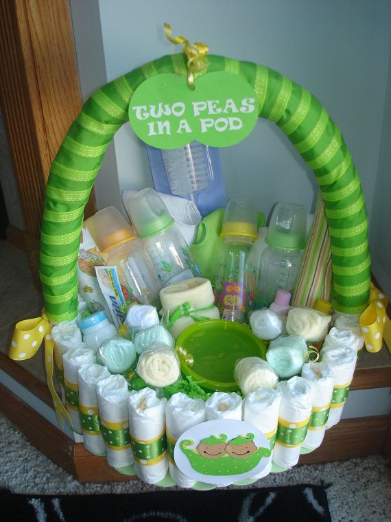 This gorgeous basket is made with diapers. Each Diaper is individualy wrapped with ribbon and glued in place. This basket is filled with baby goodies with room to add more. There are 4 bottles, 8 washcloth lollipops, 4 bibs, a bottle brush and 2 food containers with lids. I have also added 2 blankest and johnsons baby items.