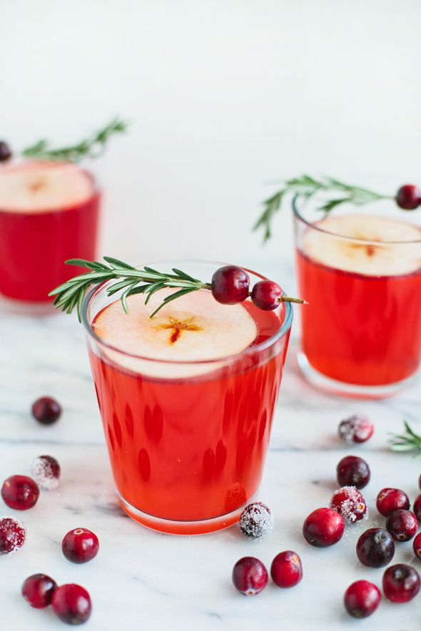 Sip on a Cranberry-Apple Cider Punch by following this easy non-alcoholic holiday mocktail recipe.