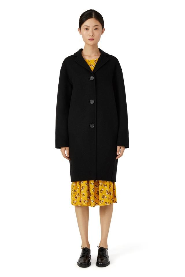 Italian camel hair black classic coat. Relaxed fit with drop shoulder and two side pockets. Three button closure. Fully double faced and unlined. Luxurious 100%