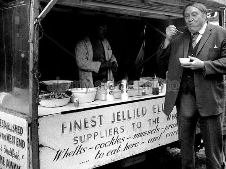 Arthur Mullard enjoying Jellied eels at Tubby Isaac's stall at Aldgate in 1974