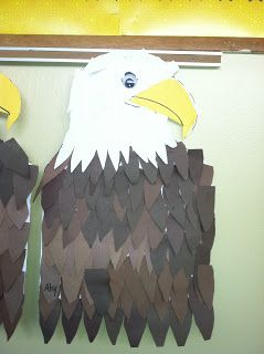 Then, starting at the bottom of your eagle glue dark brown feather and work about half way up. Make sure they are ALL overlapping and coveri...