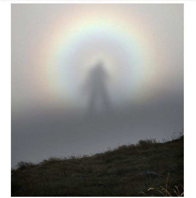 Brocken Spectre at Tatra mountains in Zakopane, Poland.  is the apparently enormous and magnified shadow of an observer, cast upon the upper surfaces of clouds opposite the sun. The phenomenon can appear on any misty mountainside or cloud bank, or even from an airplane.