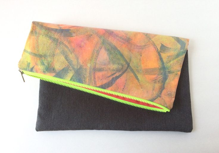 A personal favorite from my Etsy shop https://www.etsy.com/listing/228305775/clutch-bag-handmade-bag-foldover-clutch