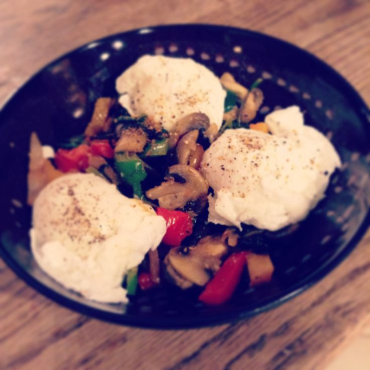 Poached eggs with sautéed veggies - mushroom, peppers, onion, spinach and tomatoes