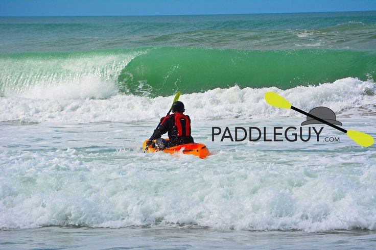 Setting off through the surf at Waihi beach Nz with Viking Kayaks
