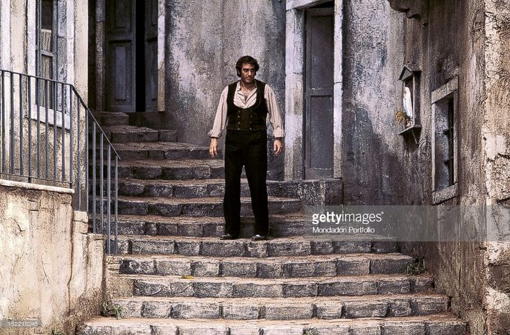 Spanish tenor Placido Domingo, dressing the part of farmer Turiddu, is on the steps of the scenography that reproduces the Sicilian village of Vizzini on the inside of Teatro alla Scala for Mascagni's 'Cavalleria Rusticana' directed by Franco Zeffirelli. Milan, February 1981.