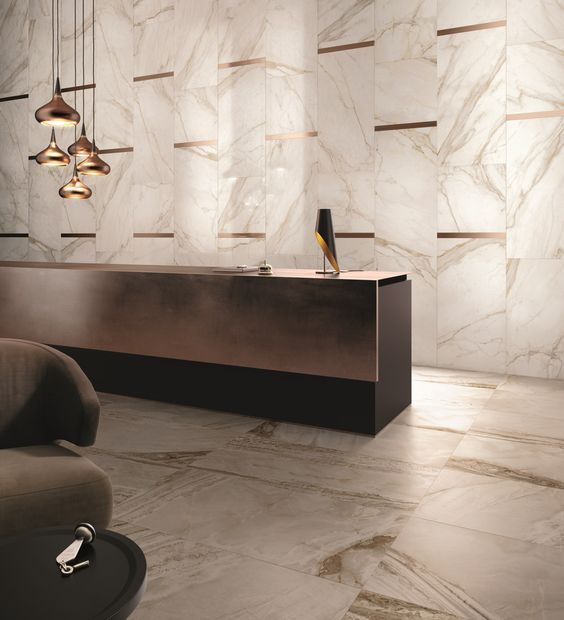 Make a Grand #Entrance- A solid metal desk and #matching marble floor and wall tiles add elegance and simplicity to this entryway. Marble's timeless fashion will usher your clients into your business with style and panache.