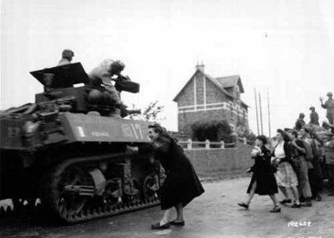Stuart Light Tank in Leclerc's division heading to Avranches. Photo: Conseil Régional de Basse-Normandie / National Archives USA