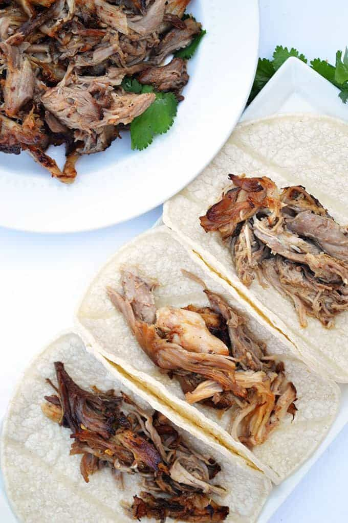Easy crock pot carnitas. Tender and juicy with just the right amount of spice. Perfect for tacos and burritos!