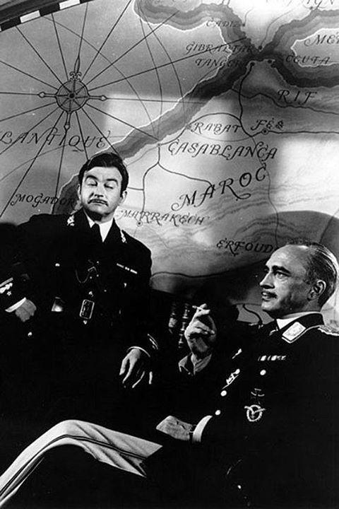 "Claude Rains, as Captain Renault; and Conrad Veidt, as Major Strasser, in ""Casablanca"" (1942)."