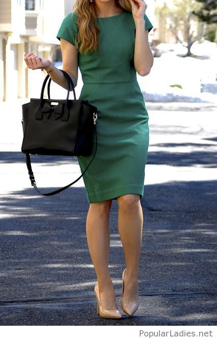 A green dress and a black bag