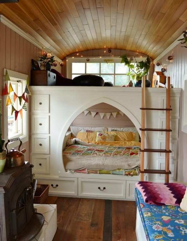 Can you believe this dreamy kid's bed is located inside a converted school bus home? Take advantage of the extra-cozy feeling of small space living by filling your little one's room with bright colors and fun patterns.