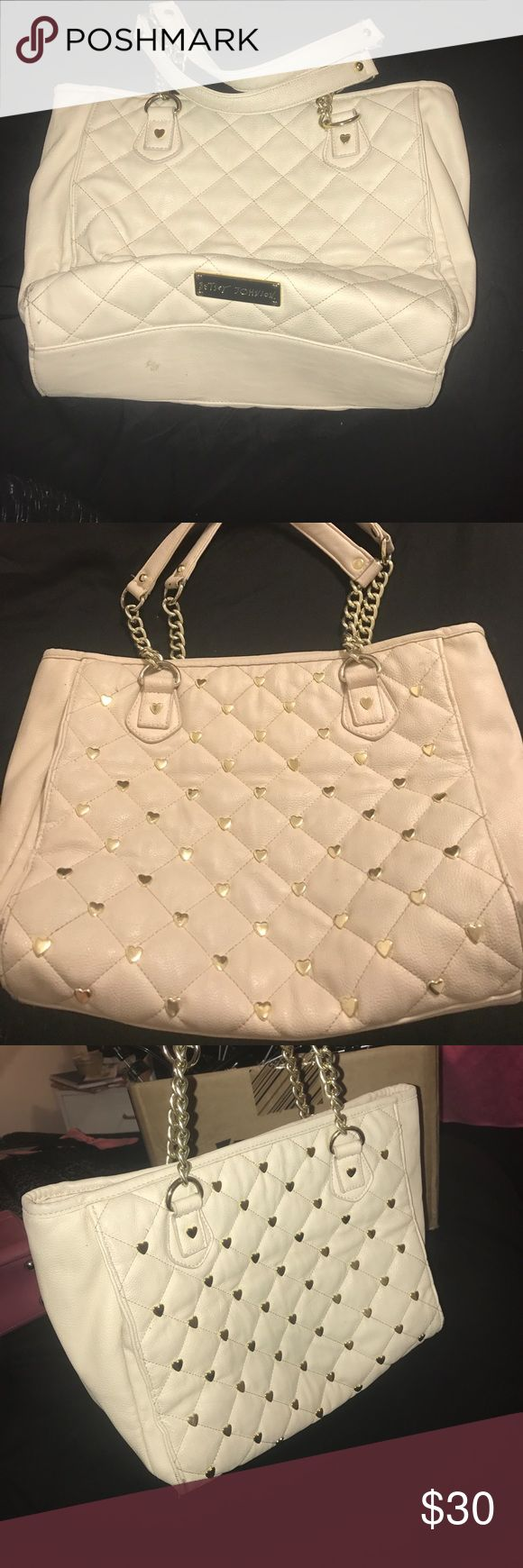 Betsey Johnson handbag This is a good used condition Betsy Johnson handbag in a cream/off-white color. Loved it and I have some scrapes/ scuffs but nothing big at all it has a zipper inside and a cell phone compartment inside as well very cute honestly to get most of the little things out you would just need to wipe it down with a leather cleaner. Betsey Johnson Bags