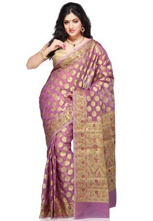 Light purple and gold polka dots  http://www.utsavfashion.com/saree/light-purple-art-silk-saree-with-blouse/sava62-itemcode