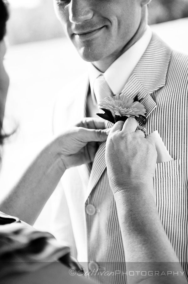 groom getting ready, with help from his mother