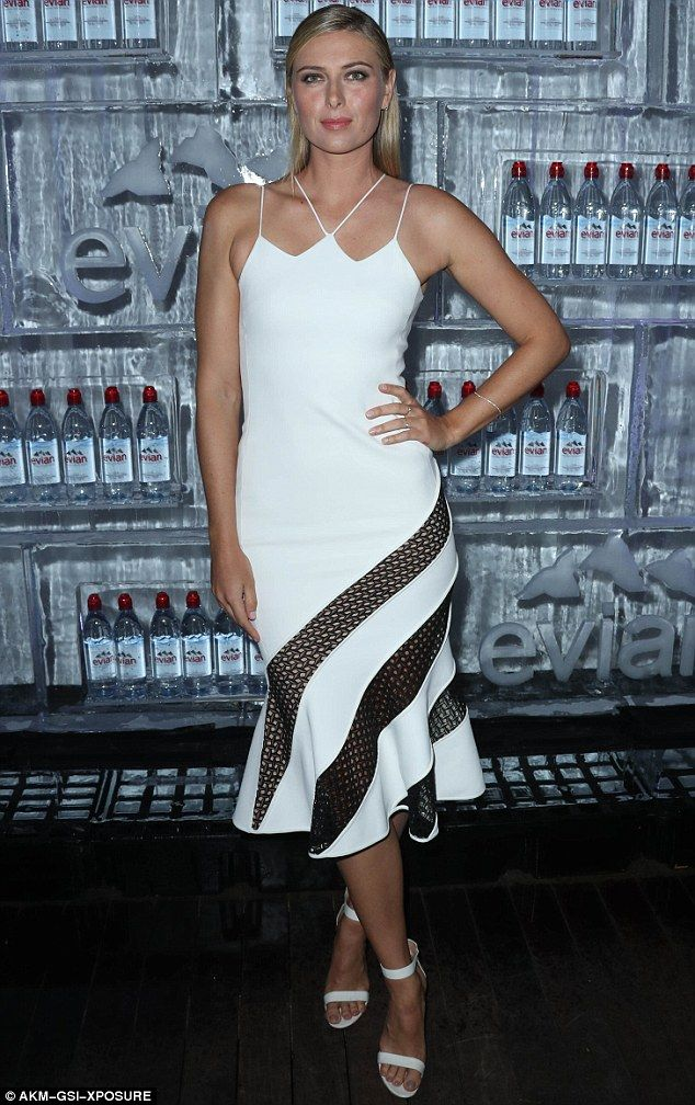 A bit of all white: Drug cheat Maria Sharapova looked in fine form at an Evian advertising campaign launch in Los Angeles on Thursday