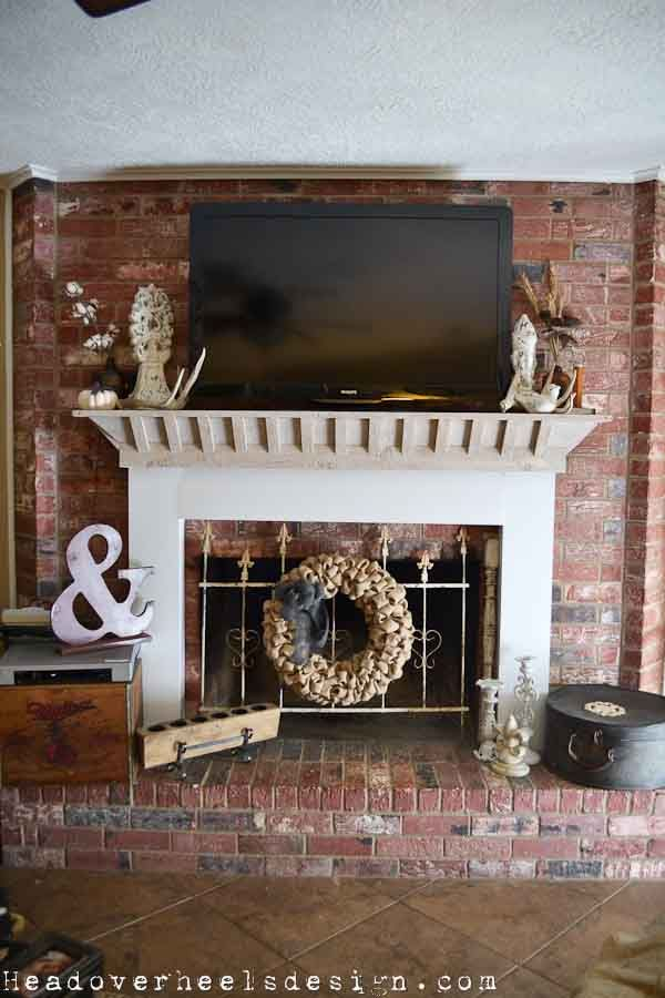 Head Over Heels Tv On A Brick Fireplace A Whitewashed