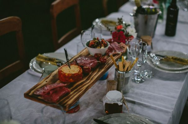 meat and cheese appetizers set out on the tables