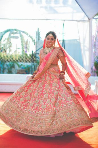 Bridal Lehengas - Twirling Bride in a Pink Wedding Lehenga with Dull Gold and Silver Embroidery and Double Dupatta   WedMeGood #wedmegood #indianbride #indianwedding #lehenga #twirling #pink #bridal #choli #dupatta