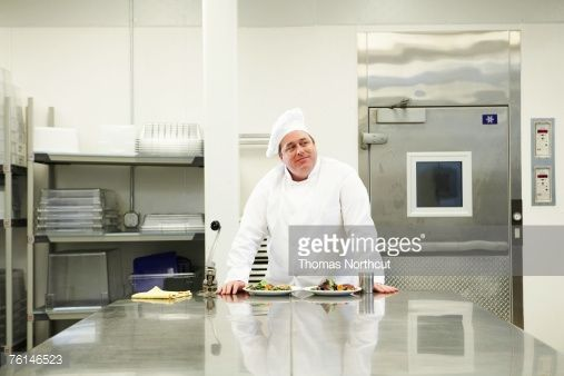 Stock Photo : Chef with food in kitchen