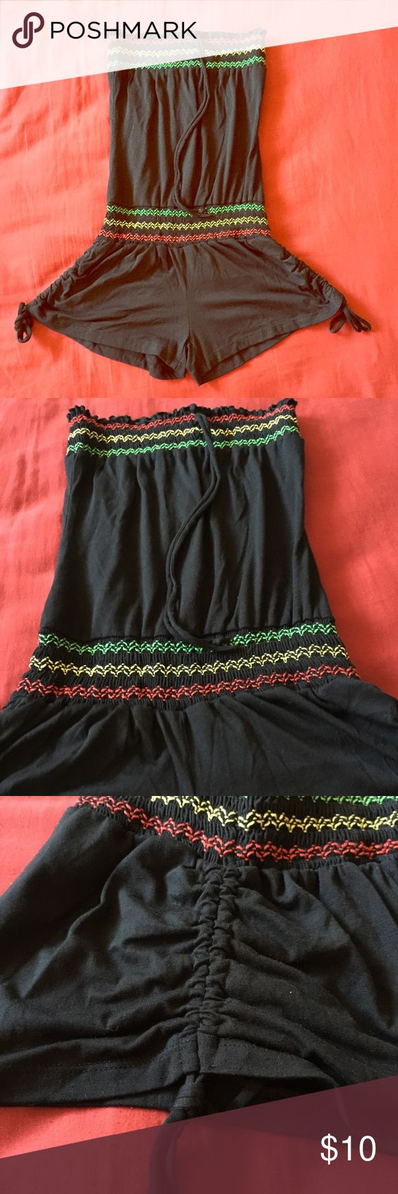 Girl's Rasta Romper Worn once! No damages. This is like a OneSize but it'll fit from girl's size 12-16. It's cute for a beach cover up too! Dresses