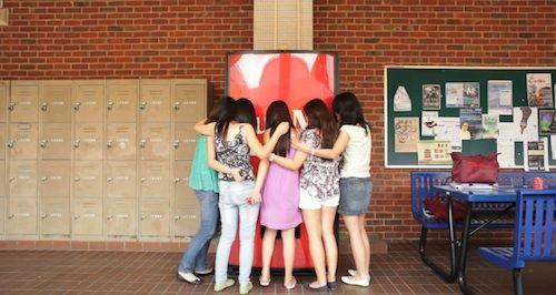 New Coca-Cola Vending Machine Dispenses Coke In Exchange For Hugs