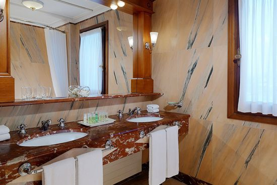 Belvedere Suite Bathroom  The marble bathroom has a separate walk in shower and bathtub and premium amenities