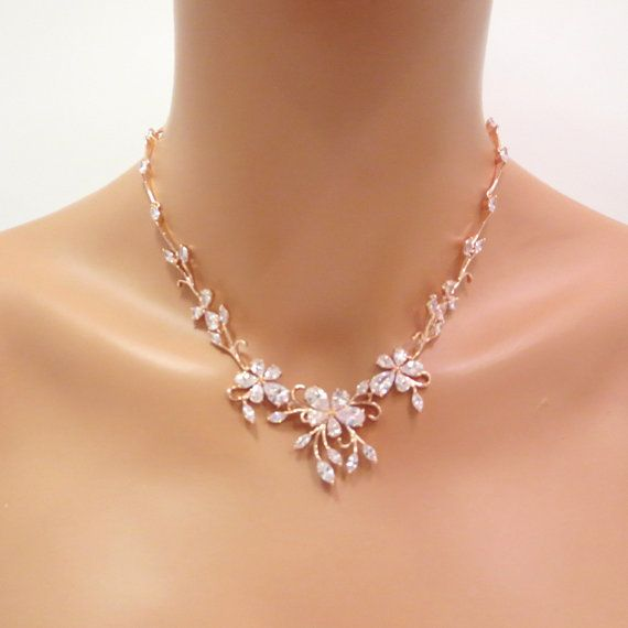 Perfect for any wedding, this delicate necklace and earrings set features sprays of cubic zirconia crystal flowers and leaves. The necklace is