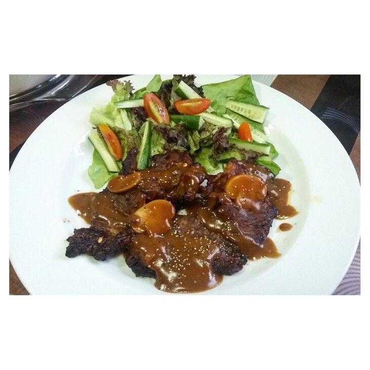 Beef steak mushroom sauce and side salad