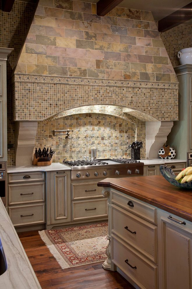 kitchen island with cooktop in Kitchen Mediterranean with beige kitchen island beige cabinets