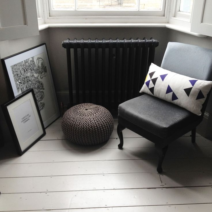 Victorian chair, white shutters, cast iron column radiator, white wood floor, knitted pouf.  Chair, artwork and geometric cushion available from www.anartfullife.co.uk