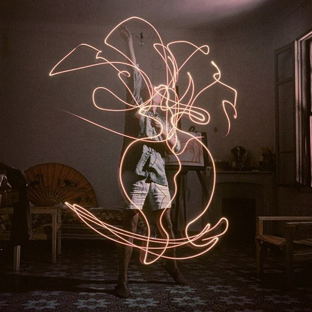 """Pablo Picasso """"paints"""" with light, photographed for Life Magazine by Gjon Mili, 1949."""