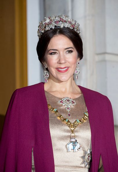 Crown Princess Mary of Denmark wore the Ruby Parure Tiara and matching jewels as well as the Order of the Elephant, which is worn on a chain-link collar on January 1, known as The Knight's Day