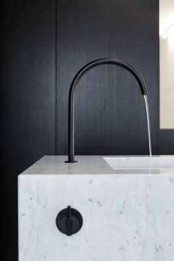 :: DETAILS :: Beautiful black water tap by Stein van Rossem paired with white marble and ebony wood.