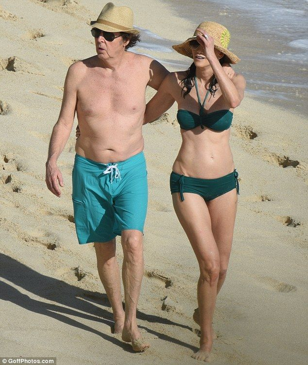 Life's a beach: On Sunday afternoon Sir Paul McCartney and his wife Nancy Shevell could have been confused for a pair of newlyweds, as they put on a loved-up display on the beach, in St. Barts