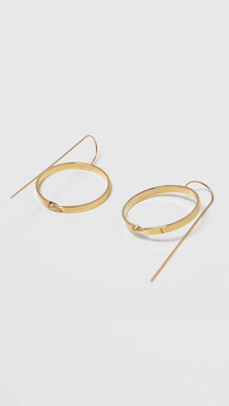 The Le Hen Circle Earring for a feminine, delicate style is crafted with a fine drop bar and finished with a large circle pendant. Nickel free. Lightweight. care instructions - Gold plating can be sub