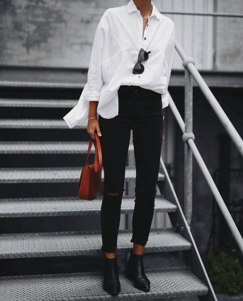Oversized white button down, black skinny jeans, ankle boots, cognac leather bag